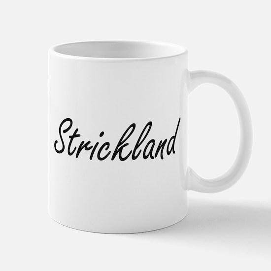 Strickland surname artistic design Mugs