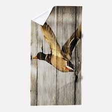 rustic western wood duck Beach Towel