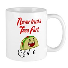 NEVER TRUST A TACO FART. Mugs