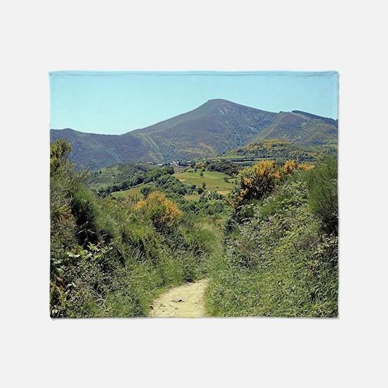 Mountains on El Camino near O'Cebrei Throw Blanket