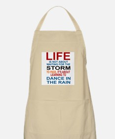 LIFE IS NOT ABOUT WAITING FOR THE STORM TO P Apron