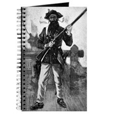 Blackbeard at attention with rifle Journal