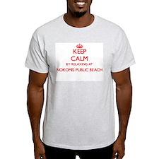 Keep calm by relaxing at Nokomis Public Be T-Shirt