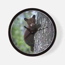 Bear Cub Climbing a Tree Wall Clock