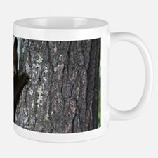 Bear Cub Climbing a Tree Mugs