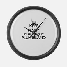 Keep calm by relaxing at Plum Isl Large Wall Clock