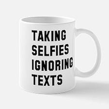 Taking selfies ignoring texts Mug