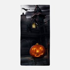 Halloween Pumpkin And Haunted House Beach Towel