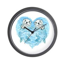sea otters holding hands Wall Clock