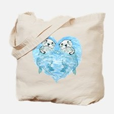 sea otters holding hands Tote Bag