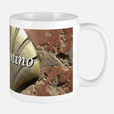 El Camino gold shell, Leon,Spain (caption) Mugs
