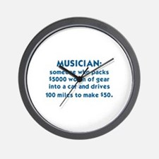 MUSICIAN: SOMEONE WHO PACKS $5000 WORTH Wall Clock