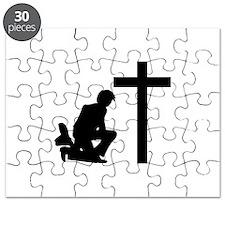 COWBOY KNEELING AT CROSS Puzzle