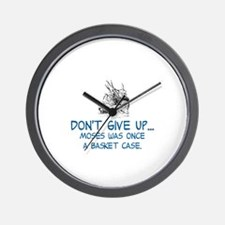 DON'T GIVE UP, MOSES WAS ONCE A BASKET  Wall Clock