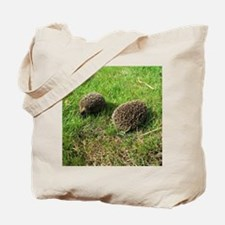 two little babies at play green grass hed Tote Bag