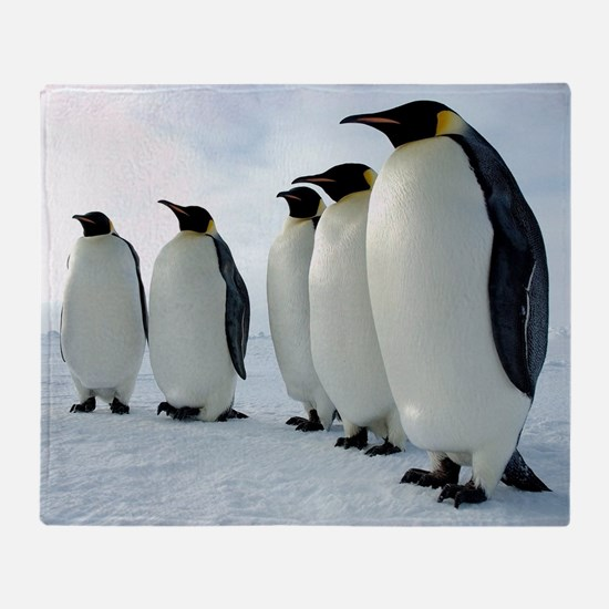 Lined up Emperor Penguins Throw Blanket