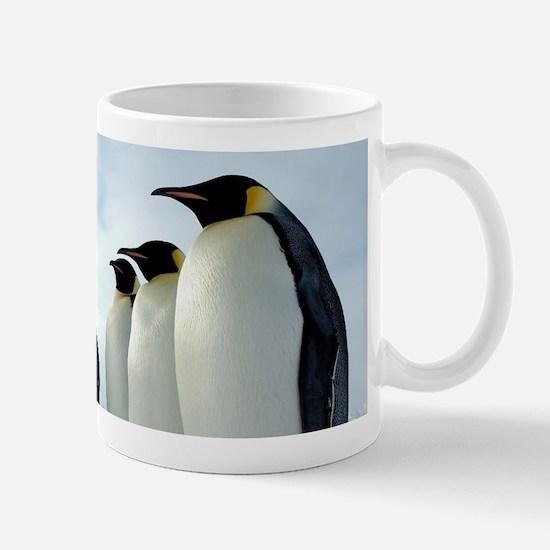 Lined up Emperor Penguins Mugs
