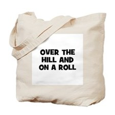 Over the hill and on a roll Tote Bag