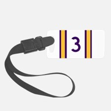 three purple and gold Luggage Tag