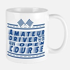 Amateur driver on an open course. Mugs