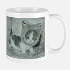 a cute kitty Mugs