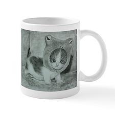 a cute kitty Mugs