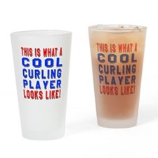 Curling Player Looks Like Drinking Glass