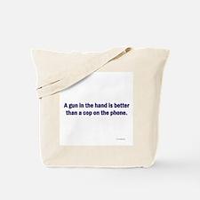 Gun in hand Tote Bag