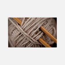 Knitting Needles Area Rug