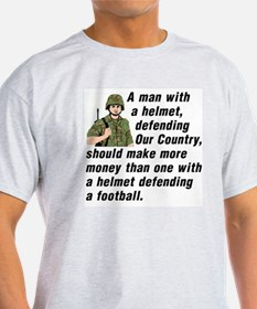 A MAN WITH A HELMET DEFENDING OUR CO T-Shirt