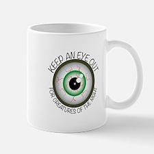 Keep Eye Out Mugs