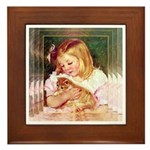 GIRL HOLDING CAT Framed Tile