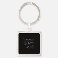 A Photograph Is A Secret Embossed Labels Keychains
