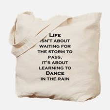 Life Isn't About Waiting For The Storm To Tote Bag