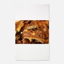 barbequed ribs close Area Rug