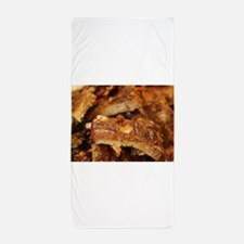 barbequed ribs close Beach Towel