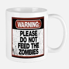 Don't Feed the Zombies Mugs