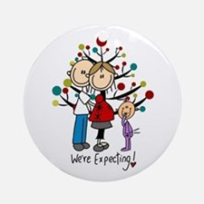 Christmas Expectant Couple With Round Ornament