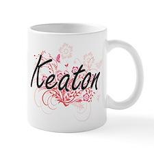 Keaton surname artistic design with Flowers Mugs