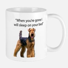 Airedale determined to sleep on your bed when Mugs