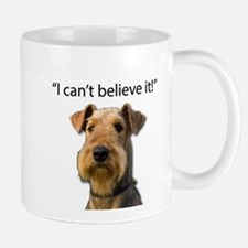 Airedale standing in disbelief Mugs