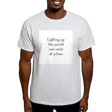 Lighting up the world one smi T-Shirt