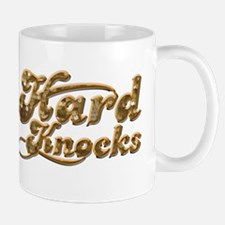 hard knocks Mugs