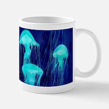 Neon Glowing Jellyfish in the Ocean Mugs