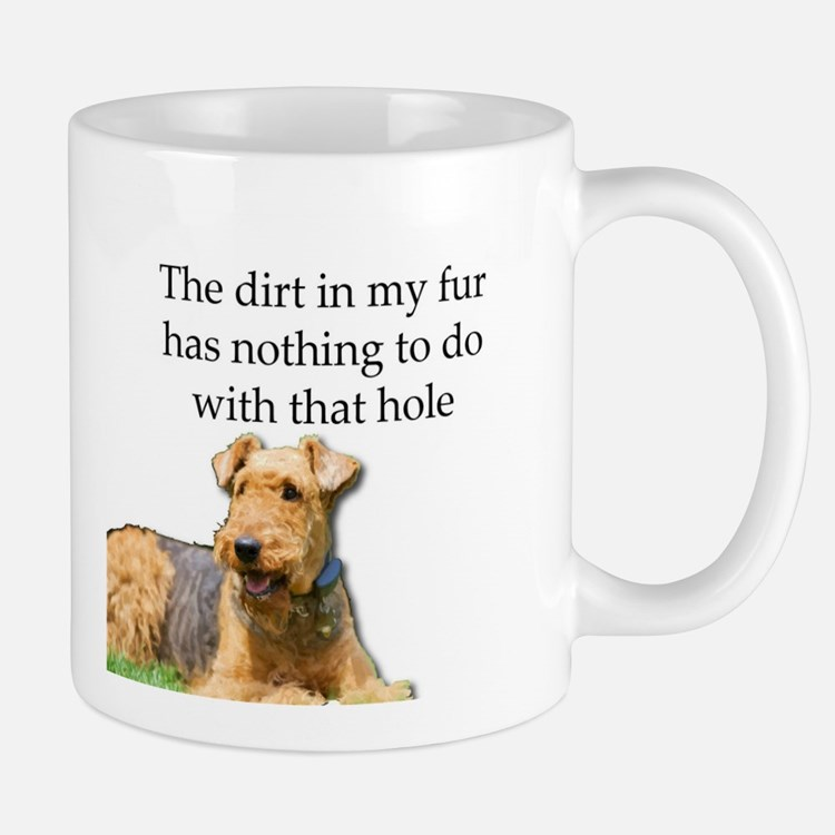 Airedale Sees no connection between his hole Mugs