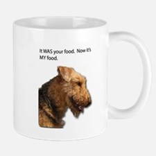 Airedale Terrier takes control of your food. Mugs