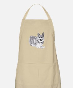 Red and White Welsh Corgi in the Snow Apron