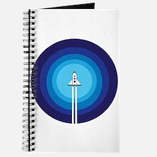 Rocket ship flies past the Blue Planet Journal