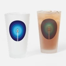 Rocket ship flies past the Blue Pla Drinking Glass