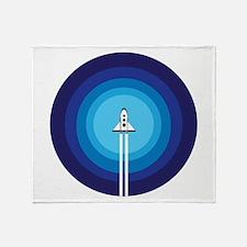 Rocket ship flies past the Blue Plan Throw Blanket